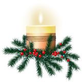 Candle with fir branches on a white background. Christmas background Royalty Free Stock Image