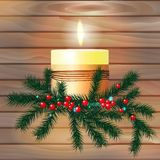 Candle with fir branches on a wooden background Stock Photos