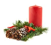 Candle and fir-tree branch composition Stock Image