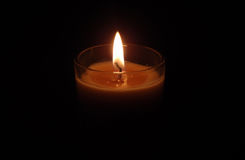 Candle on fire Royalty Free Stock Photos