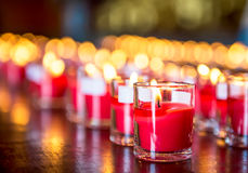 Candle and fire in glass. Red candle is kindle a fire in glass Stock Image