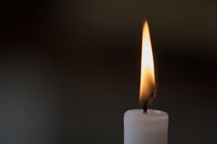 Candle flame. White candle with flame on gray background Royalty Free Stock Photos