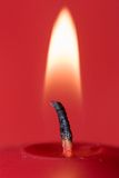 Candle Flame. The flame at the top of a red Christmas candle Stock Photos