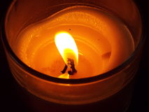 Candle. A candle flame burns in a glass Royalty Free Stock Photography