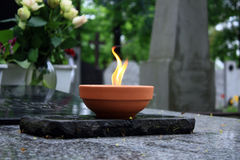 Candle flame on cemetery. Candle on the grave on the cemetery Royalty Free Stock Photography
