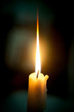 Candle flame closeup isolated on black. Stock Images