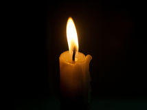 Candle flame closeup isolated on black. Royalty Free Stock Image