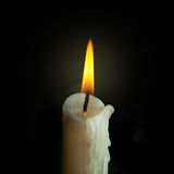 Candle flame closeup isolated on black. Stock Photography