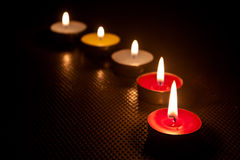 Candle and flame in dark . Royalty Free Stock Photography