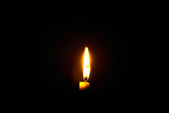 Candle  flame. A  flame from a candle at dark night background Royalty Free Stock Photos