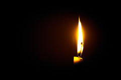 Candle  flame. A  flame from a candle at dark night background Royalty Free Stock Photography