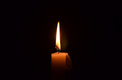 Candle flame. Flickering candle flame on a black background Stock Images