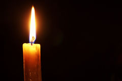 Candle flame isolated on black Stock Photography