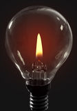 Candle flame light bulb Stock Photo