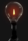 Candle flame light bulb Stock Photos