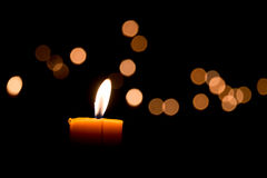 Candle flame. Light at night with bokeh on dark background Royalty Free Stock Images