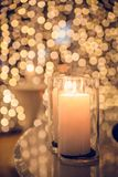 Candle flame light at night with bokeh on dark background. Stock Images