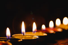 Candle flame light at night with night background. Stock Images