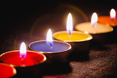 Candle flame light at night with night background. Stock Photos