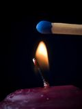Candle Flame with Match Stock Photos