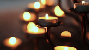 Candle flame at night in church. Abstract glowing background. stock footage