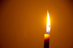 Candle  flame. A  flame from a candle in orange background Stock Image