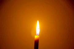 Candle  flame. A  flame from a candle in orange background Stock Photos