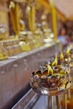 Candle flame for praying. Asian people usually praying Buddha holding lotus flower and incense stick front candle flame and image of Buddha Stock Photo