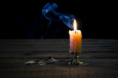 Candle, Flame, Smoke, Burnt Matches. Royalty Free Stock Photography