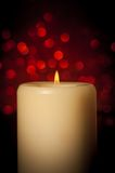 Candle with flame on wood table, christmas theme Stock Photography