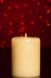 Candle with flame on wood table Stock Image