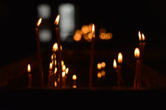 Candle flames on a black background Royalty Free Stock Photography