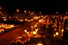 Candle flames illuminating on cemetery Stock Image