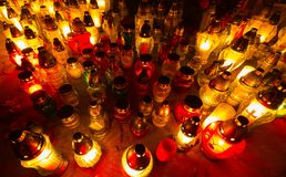 Candle flames illuminating cemetery during All Saint's Day Stock Images