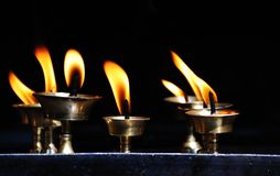 Candle flames. The image was taken in a temple in Nepal royalty free stock photos