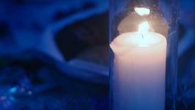Candle in a flask on the table stock footage