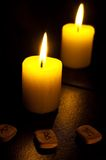 Candle and fleece. Candle and reflexion in a mirror. Nearby three fleece Royalty Free Stock Photos