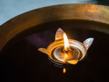 Candle floating on water close up stock images