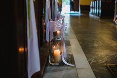 Candle on the floor in the church Royalty Free Stock Images