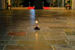 Candle on the floor. royalty free stock photo