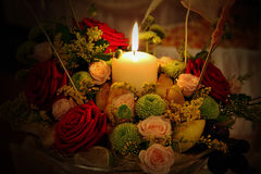 Candle and flowers. Beautiful and romantic arrangement Royalty Free Stock Photography