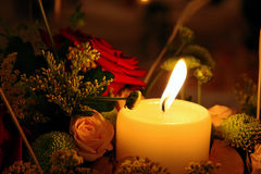Candle and flowers. Beautiful and romantic arrangement Royalty Free Stock Image