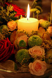 Candle and flowers. Beautiful and romantic arrangement Stock Photo