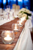 Candle with Flowers on Bridal Table Wedding Theme Royalty Free Stock Images