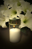 Candle and flowers for condolences Stock Image