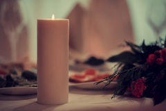 Candle and flowers on a festive table Royalty Free Stock Photos