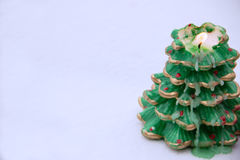 Candle in the form of the Christmas tree on the snow. Candle in the form of the Christmas tree lights on the snow Stock Photos