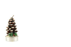 Candle in the form of a Christmas tree on a white background Royalty Free Stock Photo