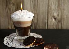 Candle in the form of cocktail glass with coffee. Handmade candle in the form of cocktail glass with coffee and creamy white foam Stock Photos