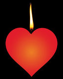 Candle in the form of red hearts Royalty Free Stock Photography